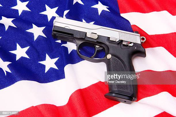 Browning hand gun on stars and stripes