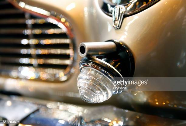 Browning machine gun in the front fender of the famous James Bond's Aston Martin DB5 used in 'Goldfinger' and 'Thunderball' films is seen during the...