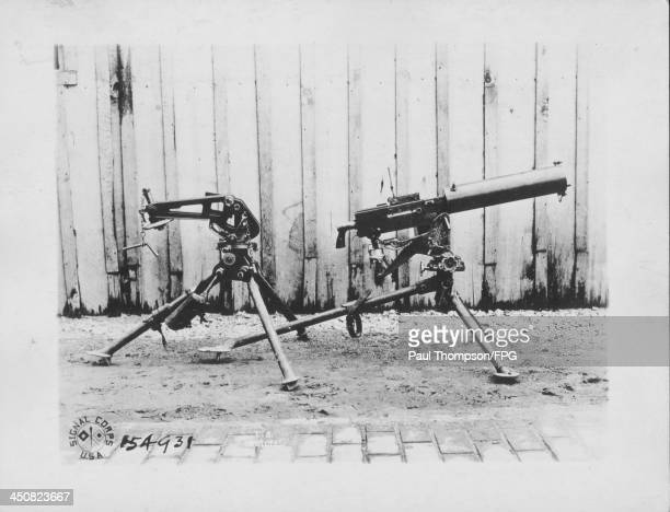A Browning mounted rifle with a new Browning auto rifle on a tripod in use during World War One Chaumont France circa 19141918