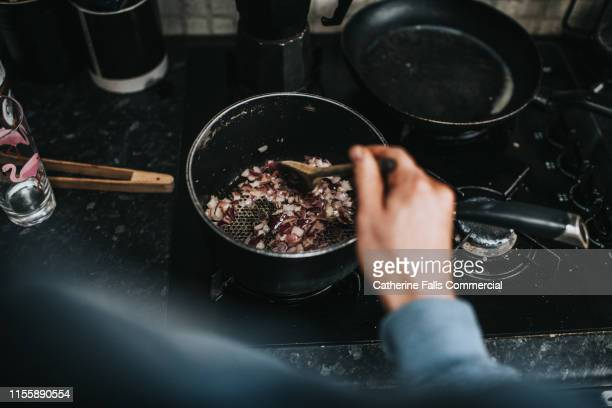 browning onions - saucepan stock pictures, royalty-free photos & images