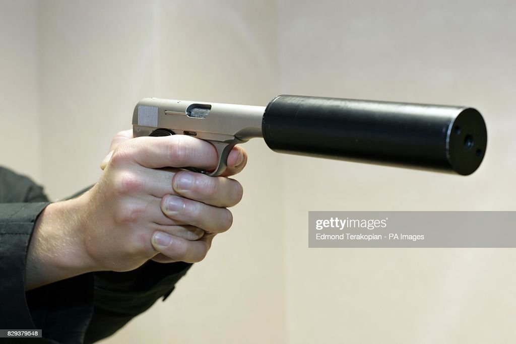 A Browning pistol which has had an Ingrams Mac 10 silencer