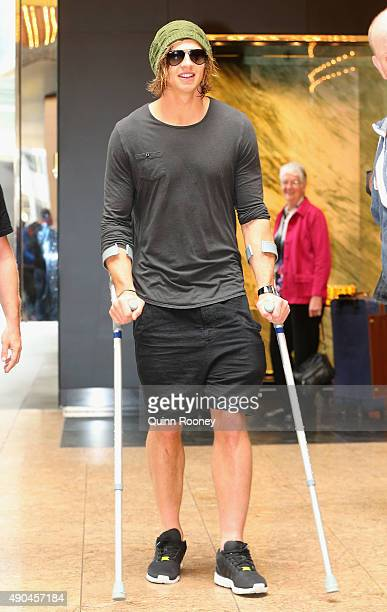 Brownlow Medal winner Nat Fyfe of the Dockers arrives at the press conference on crutches during a media opportunity at Crown Entertainment Complex...