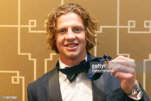 Brownlow winner Nat Fyfe of the Dockers with his medal during the 2019 Brownlow Medal at Crown Palladium on September 23 2019 in Melbourne Australia