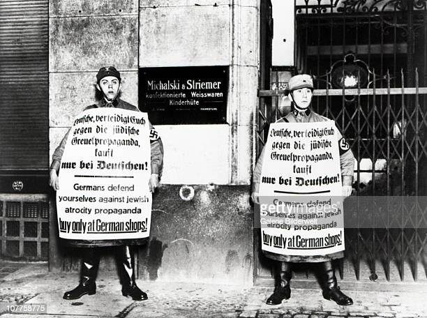 SA Brownshirts In Berlin Members of the SA Storm Division in front of a Jewish store with signs reading 'Germans defend yourselves against Jewish...