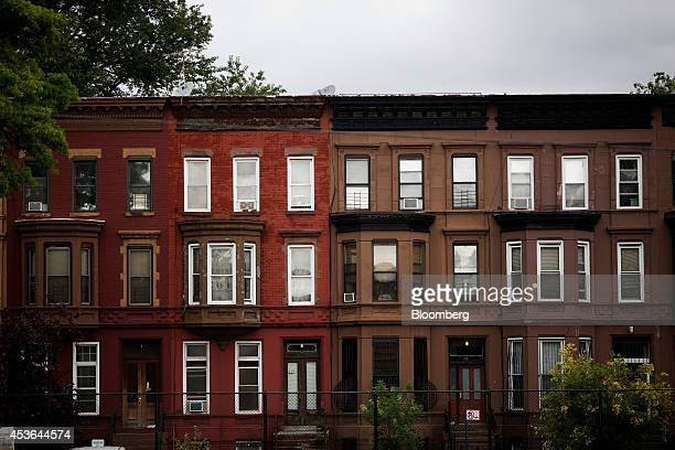 Brownstone buildings line a street of the BedfordStuyvesant neighborhood in the Brooklyn borough of New York US on Wednesday Aug 13 2014 CityShares...