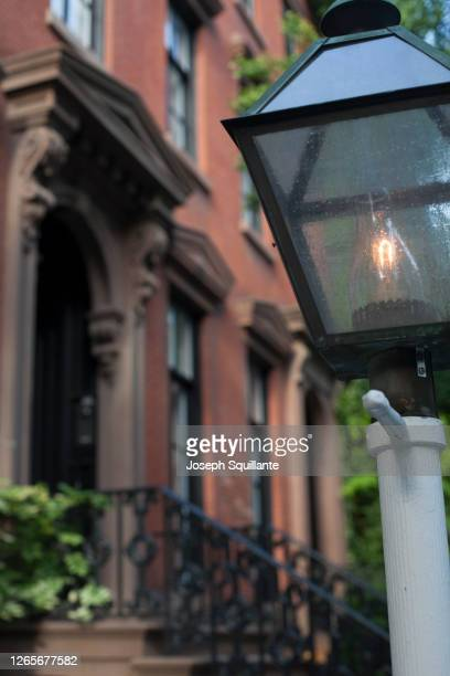 brownstone buildings with lantern - joseph squillante stock pictures, royalty-free photos & images