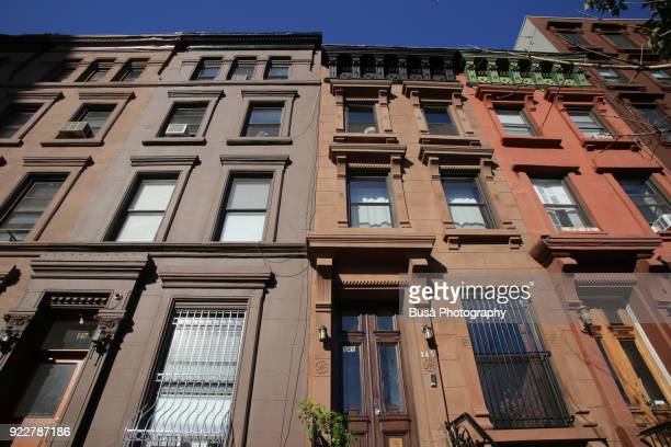 Brownstones and townhouses along 126th Street in Harlem. Manhattan, New York City