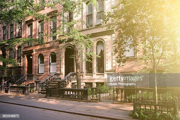 brownstones in a quiet residential street in manhattan, new york city - chelsea new york stock pictures, royalty-free photos & images
