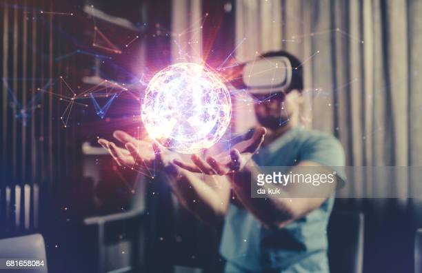 browsing a virtual world in virtual reality glasses - augmented reality stock pictures, royalty-free photos & images