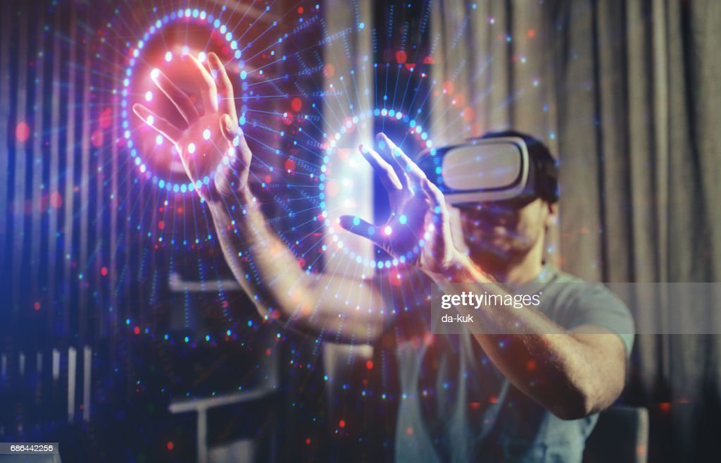 Browsing a Virtual World in Virtual Reality Glasses : Stock Photo