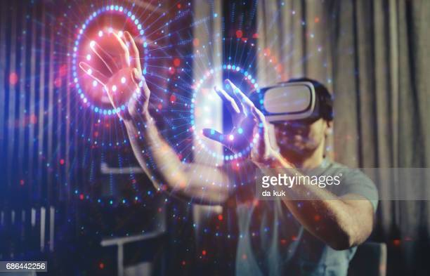 browsing a virtual world in virtual reality glasses - virtual reality simulator stock photos and pictures