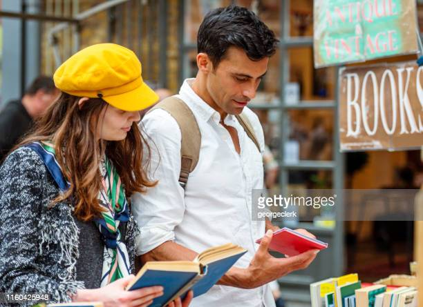 browsing books at a market stall - greenwich london stock pictures, royalty-free photos & images