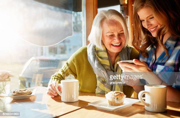browsing through their snapshots of memories - two generation family stock pictures, royalty-free photos & images