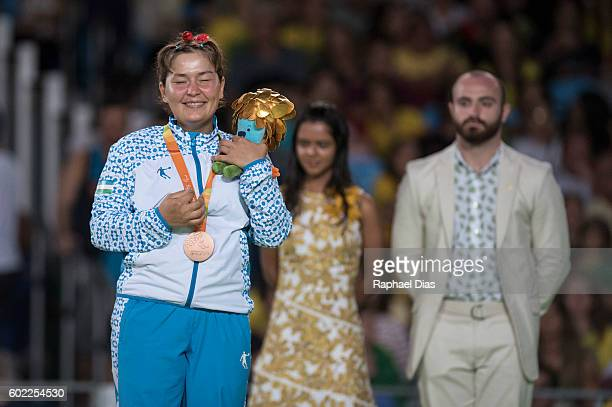 Broze medalist Gulruh Rahimova of Uzbekistan celebrates on the podium at the medal ceremony for Women 70kg Judo Gold Medal bout on Day 3 of the Rio...