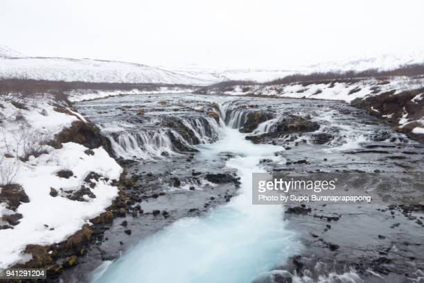 """bruarfoss is also called the blue waterfall and means """"bridge over waterfall"""".the waterfall is very photogenic because of this shape and the blue color of the water - thingvellir national park stock photos and pictures"""