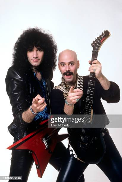 Bruce and Bob Kulick studio portrait in New York City on May 7 1985 Bob Kulick is holding a Washburn G35V guitar