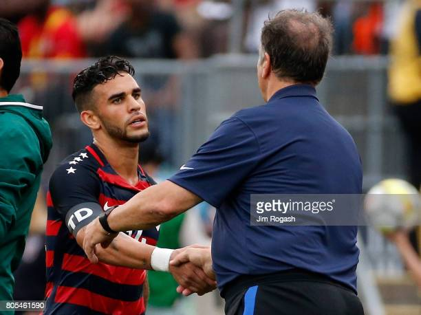 Bruce Arena head coach of United States shakes hands with Dom Dwyer in the second half during an international friendly between USA and Ghana at...