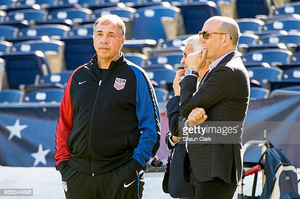 Bruce Arena of the United States talks to Sunil Gulati and Don Garber during the International Soccer Friendly match between the United States and...