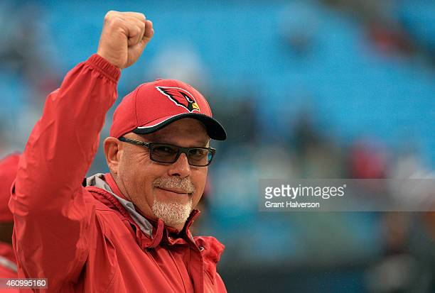 Bruce Arians head coach of the Arizona Cardinals looks on prior to their NFC Wild Card Playoff game against the Carolina Panthers at Bank of America...