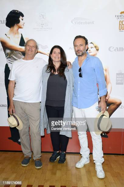 Bruce Beresford Julia Ormond and Vincent Perez attend the 65th Taormina Film Fest photocall at Teatro Antico on June 30 2019 in Taormina Italy