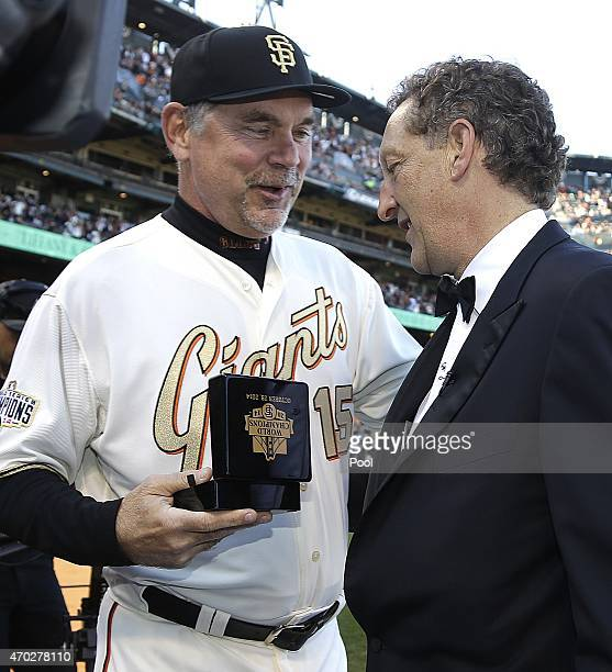 Bruce Bochy of the San Francisco Giants is presented with a World Series Ring by Larry Baer during the San Francisco Giants 2014 World Series Ring...