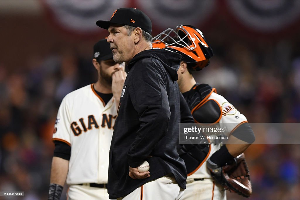 Bruce Bochy #15 of the San Francisco Giants stands on the pitchers mound during a change in the ninth inning of Game Four of their National League Division Series against the Chicago Cubs at AT&T Park on October 11, 2016 in San Francisco, California.