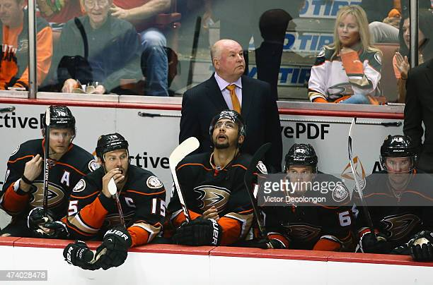 Bruce Boudreau of the Anaheim Ducks stands behind his team as they play the Chicago Blackhawks during overtime of Game Two of the Western Conference...