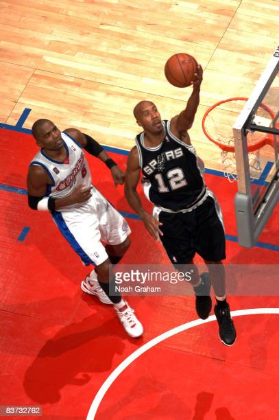 Bruce Bowen of the San Antonio Spurs goes up for a layup while Cuttino Mobley of the Los Angeles Clippers looks on during their game at Staples...