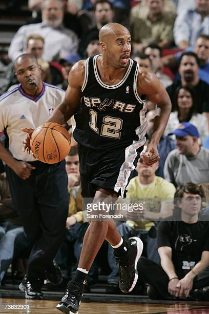 Bruce Bowen of the San Antonio Spurs moves the ball against the Portland Trail Blazers during the game at the Rose Garden Arena on March 6 2007 in...