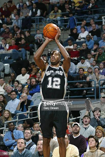 Bruce Bowen of the San Antonio Spurs shoots against the Milwaukee Bucks during the game at Bradley Center on March 11 2003 in Milwaukee Wisconsin The...