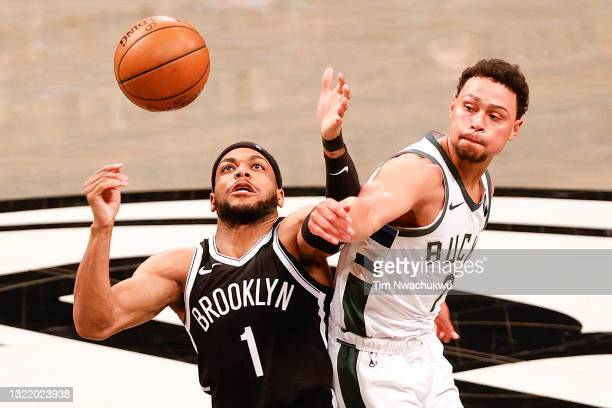 Bruce Brown of the Brooklyn Nets and Bryn Forbes of the Milwaukee Bucks reach for the ball during the second quarter during Game One of the Eastern...