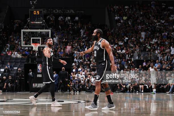 Bruce Brown of the Brooklyn Nets high fives James Harden of the Brooklyn Nets during the game against the Milwaukee Bucks during Round 2, Game 7 of...