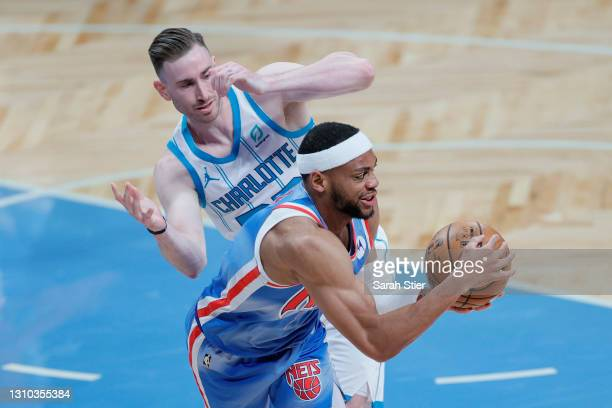 Bruce Brown of the Brooklyn Nets looks to pass as Gordon Hayward of the Charlotte Hornets defends during the first half at Barclays Center on April...