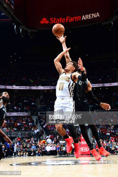 Bruce Brown of the Detroit Pistons blocks Trae Young of the Atlanta Hawks shot on February 22 2019 at State Farm Arena in Atlanta Georgia NOTE TO...