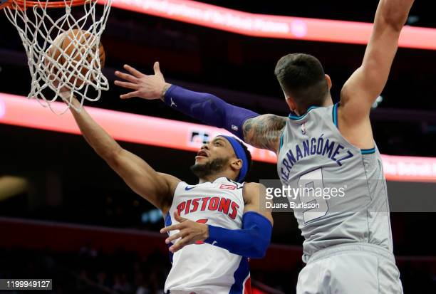 Bruce Brown of the Detroit Pistons goes to the basket last Willy Hernangomez of the Charlotte Hornets during the second half at Little Caesars Arena...