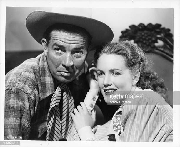 Bruce Cabot sitting close to Barbara Britton in a scene from the film 'Gunfighters' 1947
