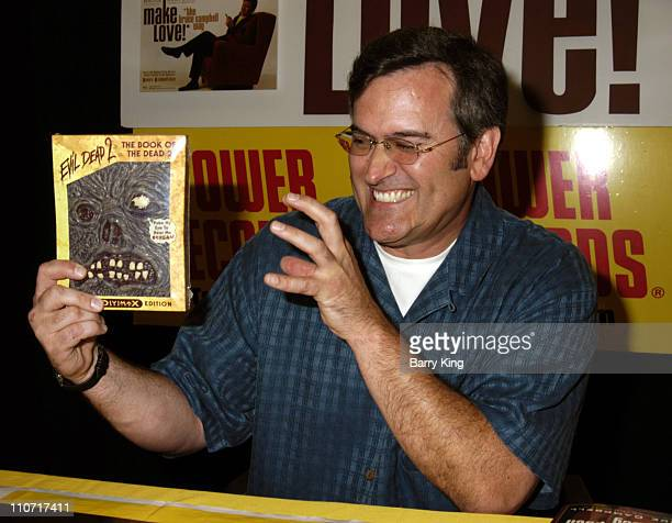 "Bruce Campbell with ""The Evil Dead 2"" DVD"