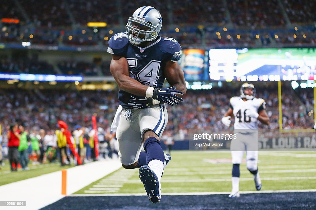 Bruce Carter #54 of the Dallas Cowboys celebrates after intercepting the ball for a touchdown against Cory Harkey #46 of the St. Louis Rams in the fourth quarter at the Edward Jones Dome on September 21, 2014 in St. Louis, Missouri. The Cowboys beat the Rams 34-31.