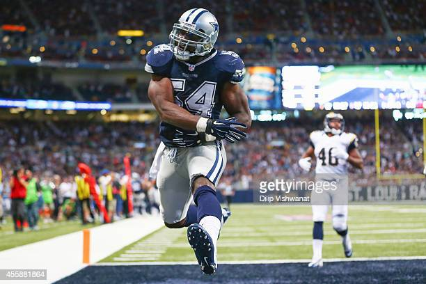 Bruce Carter of the Dallas Cowboys celebrates after intercepting the ball for a touchdown against Cory Harkey of the St Louis Rams in the fourth...