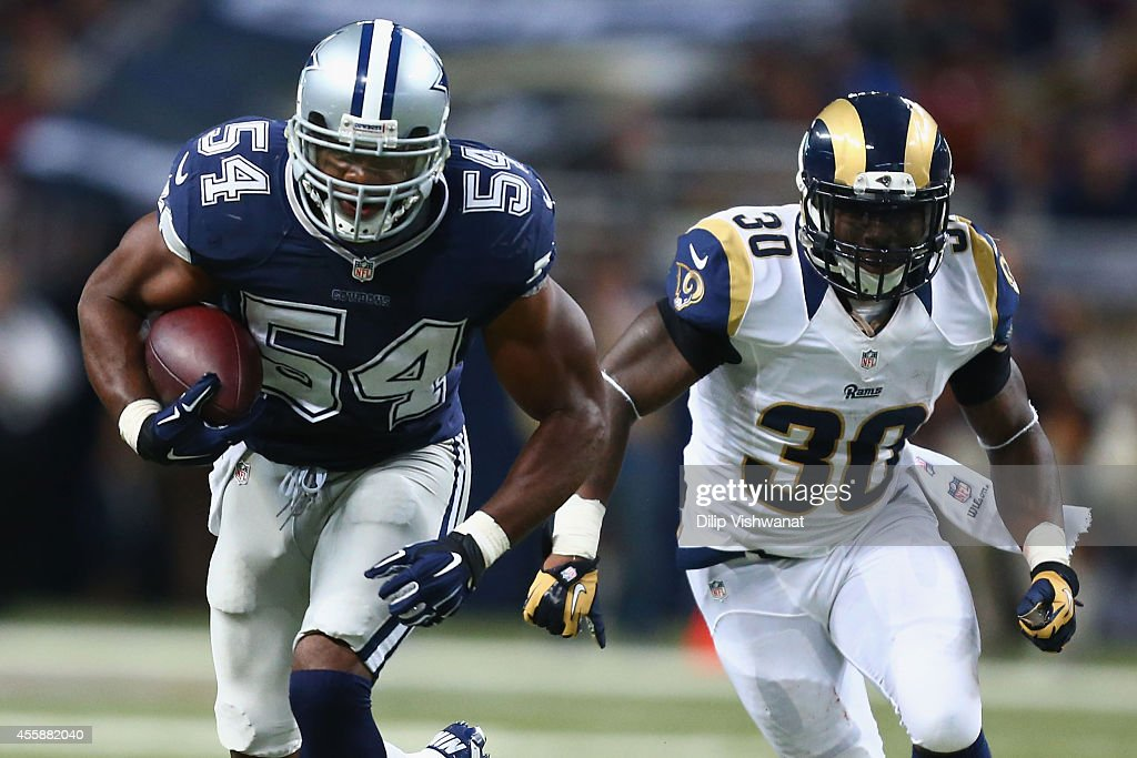 Bruce Carter #54 of the Dallas Cowboys returns an interception for a touchdown against Zac Stacy #30 of the St. Louis Rams in the fourth quarter at the Edward Jones Dome on September 21, 2014 in St. Louis, Missouri. The Cowboys beat the Rams 34-31.