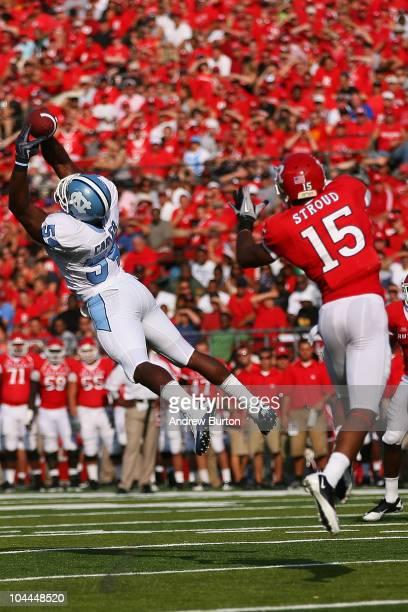 Bruce Carter of the North Carolina Tar Heels intercepts a pass intented for Keith Stroud of the Rutgers Scarlet Knights during the second quarter at...