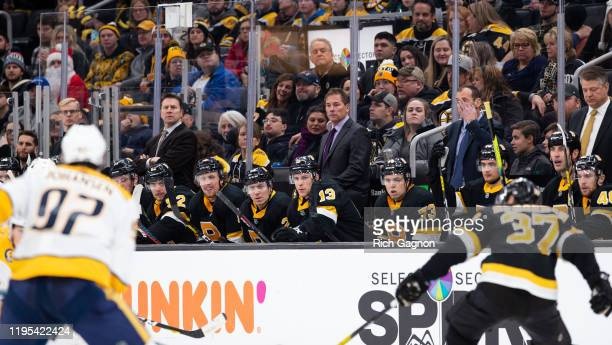 Bruce Cassidy the head coach of the Boston Bruins stands behind the bench during a game against the Nashville Predators at TD Garden on December 21...