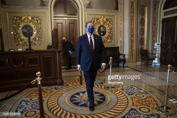 Bruce Castor, defense attorney for Donald Trump, wears a protective mask while walking through the Senate Reception Room corridor at the U.S. Capitol...