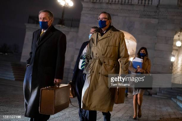 Bruce Castor, right and Michael van der Veen, lawyers on former President Donald Trumps legal team, leave the Capitol after the fourth day of Trumps...