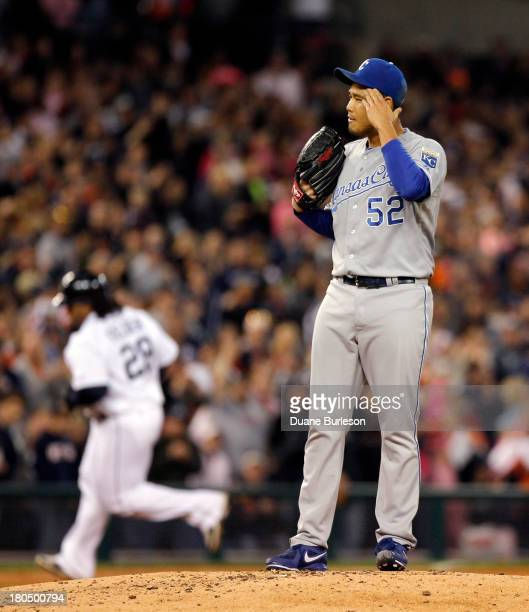 Bruce Chen of the Kansas City Royals wipes his brow as Prince Fielder of the Detroit Tigers rounds the bases after hitting a tworun home run in the...