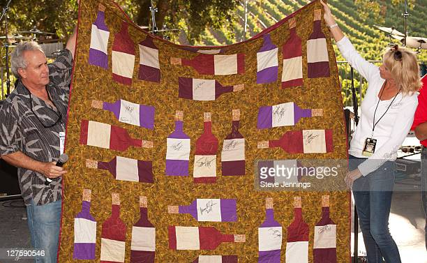 Bruce Cohn holds up artist autographed quilt to auction off at the BR Cohn Charity Concert at the BR Cohn Winery Amphitheater on September 24 2011 in...