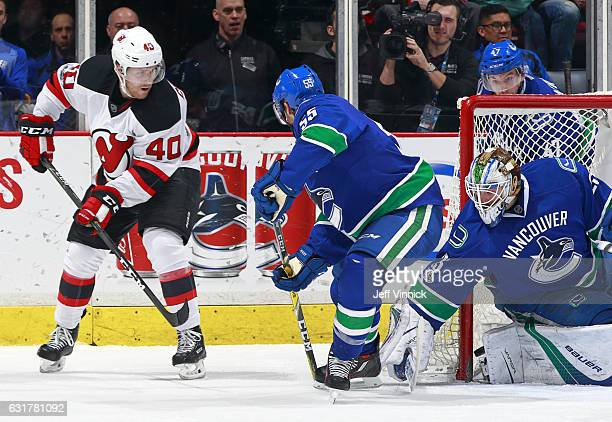 Bruce Coleman of the New Jersey Devils shoots past Alex Biega as he scores on Jacob Markstrom of the Vancouver Canucks during their NHL game at...