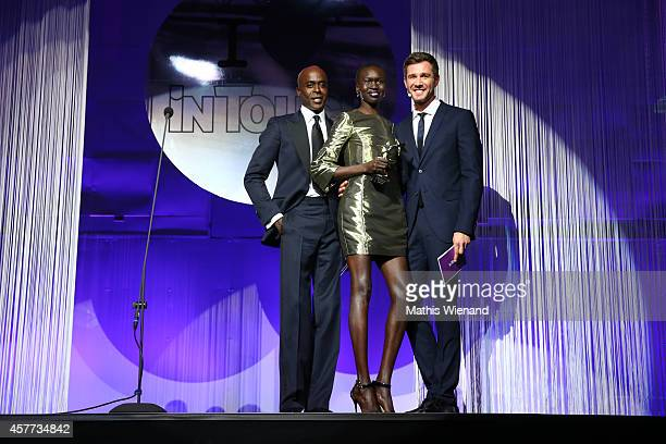 Bruce Darnell Alek Wek and Jochen Schropp attend the InTouch Awards 2014 at Port Seven on October 23 2014 in Duesseldorf Germany