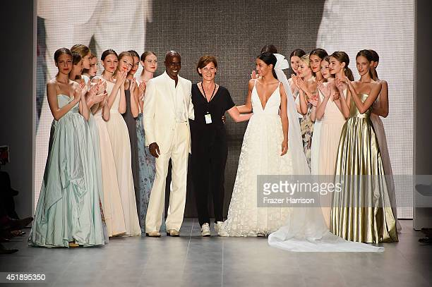 Bruce Darnell Eva Lutz and Rebecca Mir walk the runway at the Minx by Eva Lutz show during the MercedesBenz Fashion Week Spring/Summer 2015 at Erika...