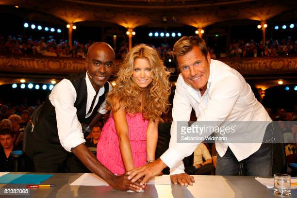 Bruce Darnell Sylvie van der Vaart and Dieter Bohlen push a buzzer during the photocall of the new TV show 'The Supertalent' on August 16 2008 in...